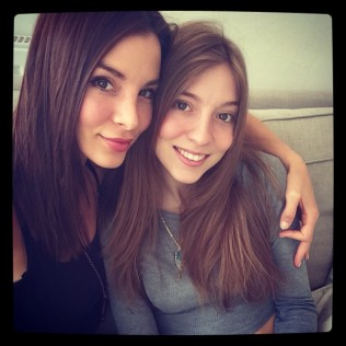 Kacey Barnfield with her arm around her beautiful sister.