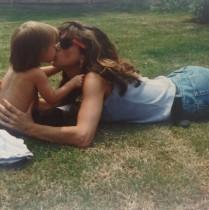 Model Karen clarke kissing her young daughter.