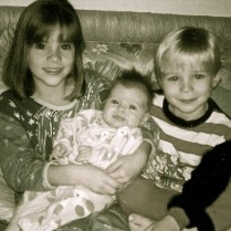 Young Kacey Barnfield with her siblings.