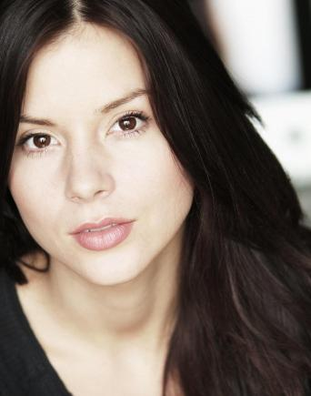 Kacey Barnfield head shot looking into the camera with very clear skin.