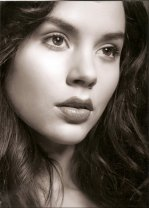 Beautiful close-up of Kacey Barnfield gazing into the distance.