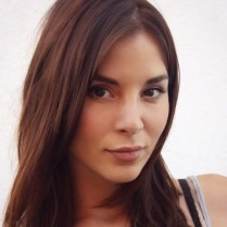 Kacey Barnfield looking at camera.
