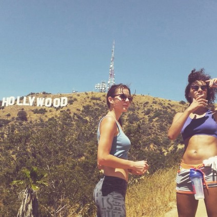 Two hot girls in front of the Hollywood sign.