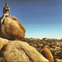 Hot girl on a boulder in the American desert.