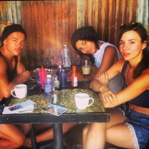 Kacey Barnfield having drinks with two friends.