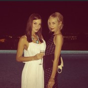 Two hot girls on a balcony.