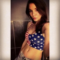 Hot chick in star spangled banner crop top baring toned belly.