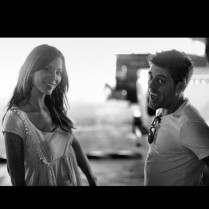 Kacey Barnfield next to guy who looks like Perez Hilton.