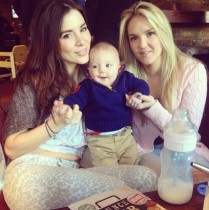 Two pretty ladies with a baby.