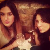 Two girls having drinks.