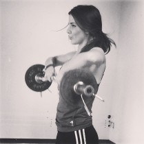 Hot girl working out with weights.