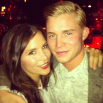 Kacey Barnfield with her brother.