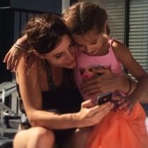 Kacey Barnfield with cute little girl.