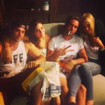 Two couples on a couch.