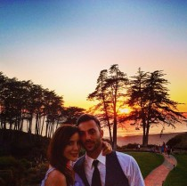 Couple in front of a sun set.