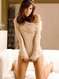Kacey Barnfield coyly stretching down her sweater to cover her crotch.