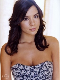 Medium close-up shot of Kacey Barnfield in a floral dress.