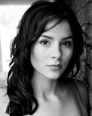 Black and white shot of Kacey Barnfield looking at the camera.