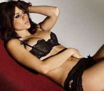 Kacey Barnfield lying back in sexy bra and panties.