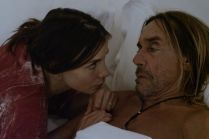Actress Kacey Barnfield resting her head to Iggy Pop in bed.