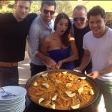 Group of people with a big tortilla.