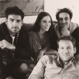Cast relaxing together off set.