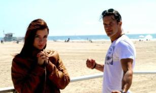 Kacey Barnfield standing on a peer with Michael Worth.