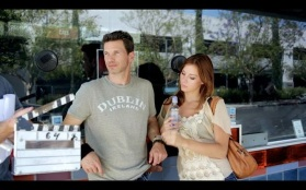Kacey Barnfield and Michael Worth with a clapper board.