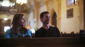 Kacey Barnfield and Michael Worth sitting in a church.
