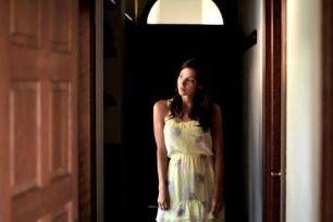 Actress Kacey Barnfield wearing a yellow dress.
