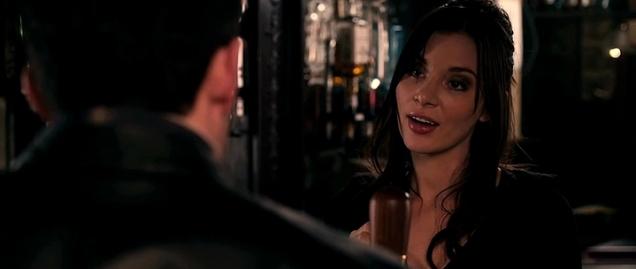 Hot barmaid flirting with customer in London pub.
