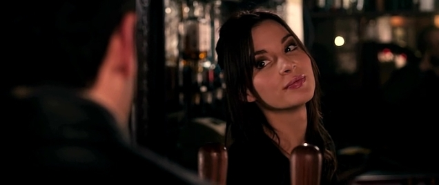 Hot barmaid flirting with customer in London pub.