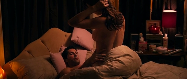 Actress topless from behind while in bed with Scott Adkins.