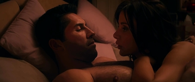 Actress having pillow talk with Scott Adkins after sex.