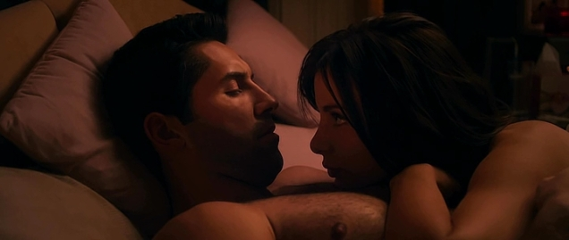 Actress having pillow talk with Scott Adkins after sex.