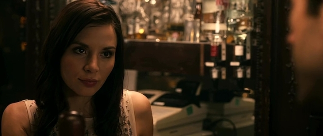 Hot barmaid looking unimpressed in London pub.