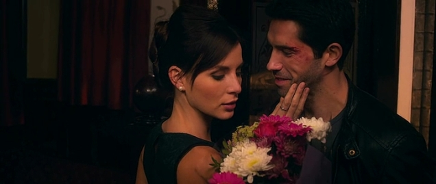 Actress is handed flowers by Scott Adkins.