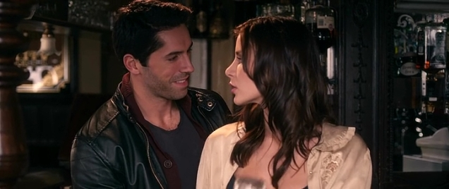 Hot barmaid looking unhappy with Scott Adkins.