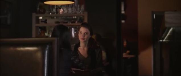 Actress talking to Jemma Dallender at table.