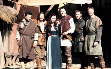 Cast group photo in medieval dress.