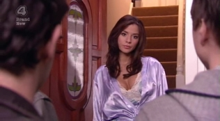 Actress opening the door to Simon Bird and James Buckley while wearing sexy attire.