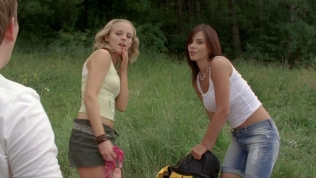 Actress standing next to Angelica Penn.