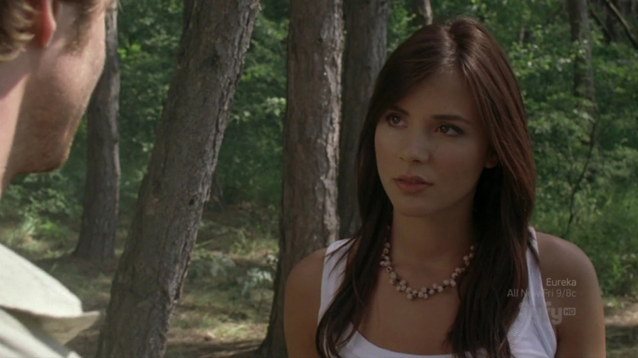 Kacey Clarke looking moody in forest.