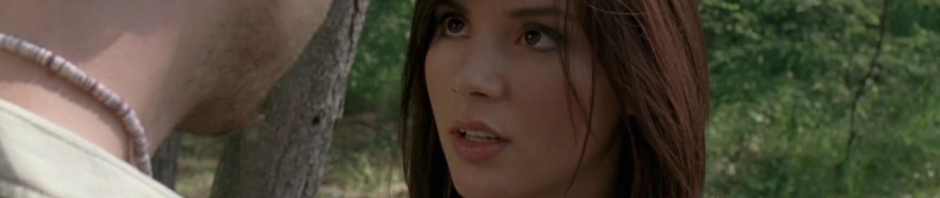 Moody actress close up in forest.