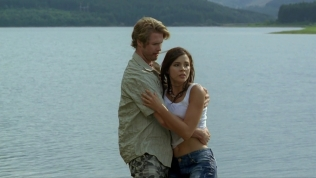 Actress being consoled by Nils Hognestad.