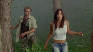 Actress in skimpy white shirt looking shocked.