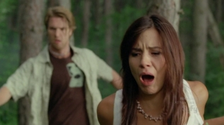 Cute actress with her mouth open in shock.