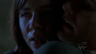 Close-up of actress looking upset at night.