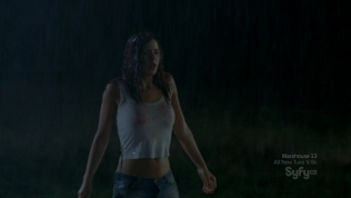 Hot actress in wet white shirt looking traumatized.