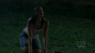 Hot actress in wet white shirt dropping to her knees at night.